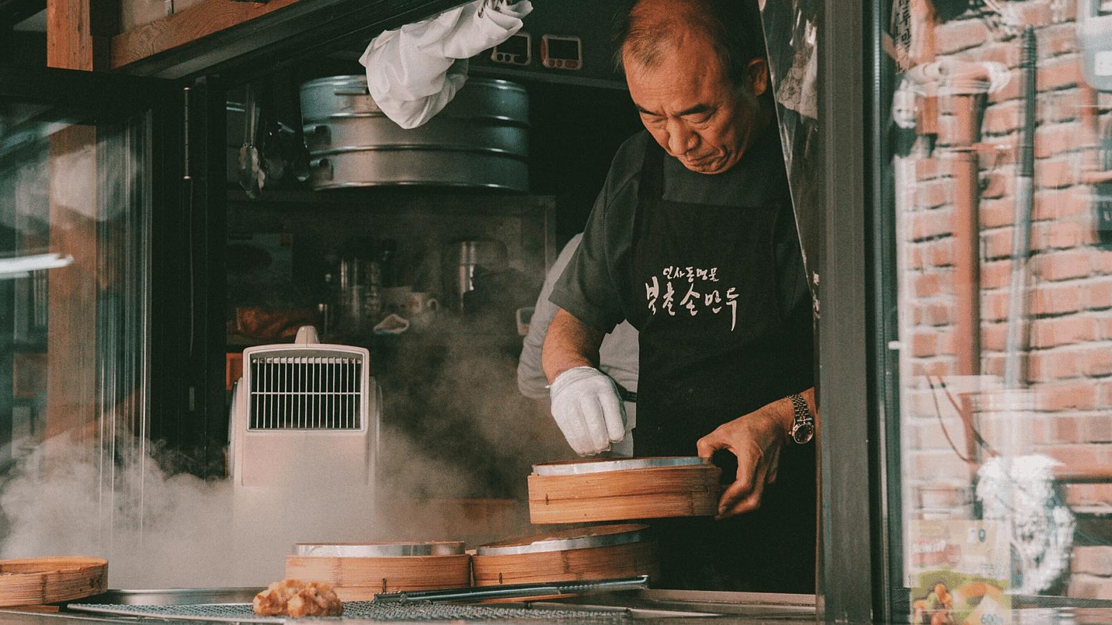 Man cooking dumplings chef