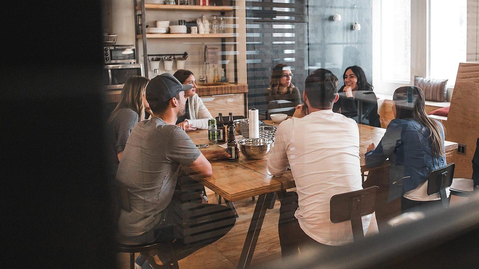 A restaurant team having a meeting.