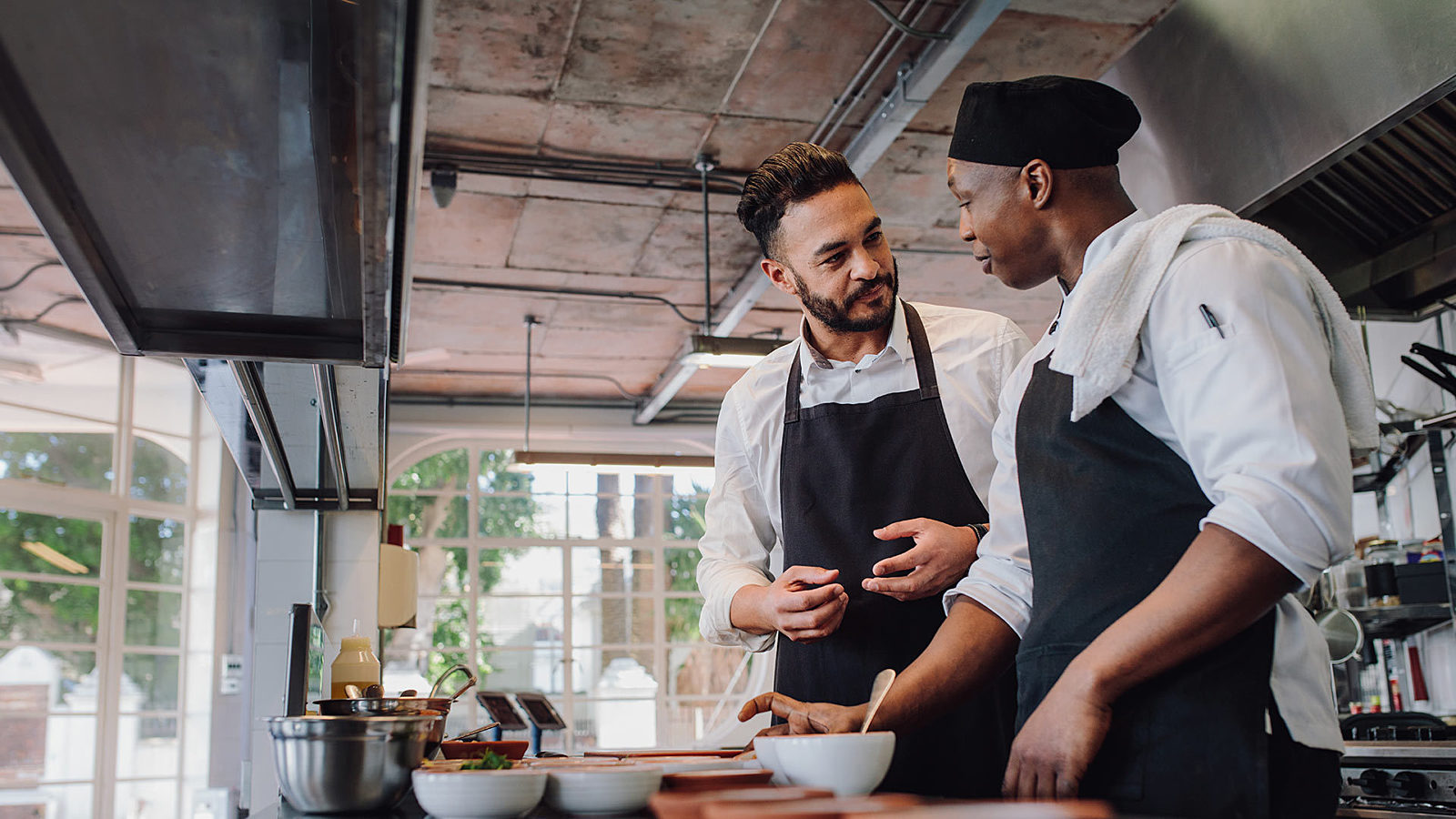 Two employees talking in the kitchen