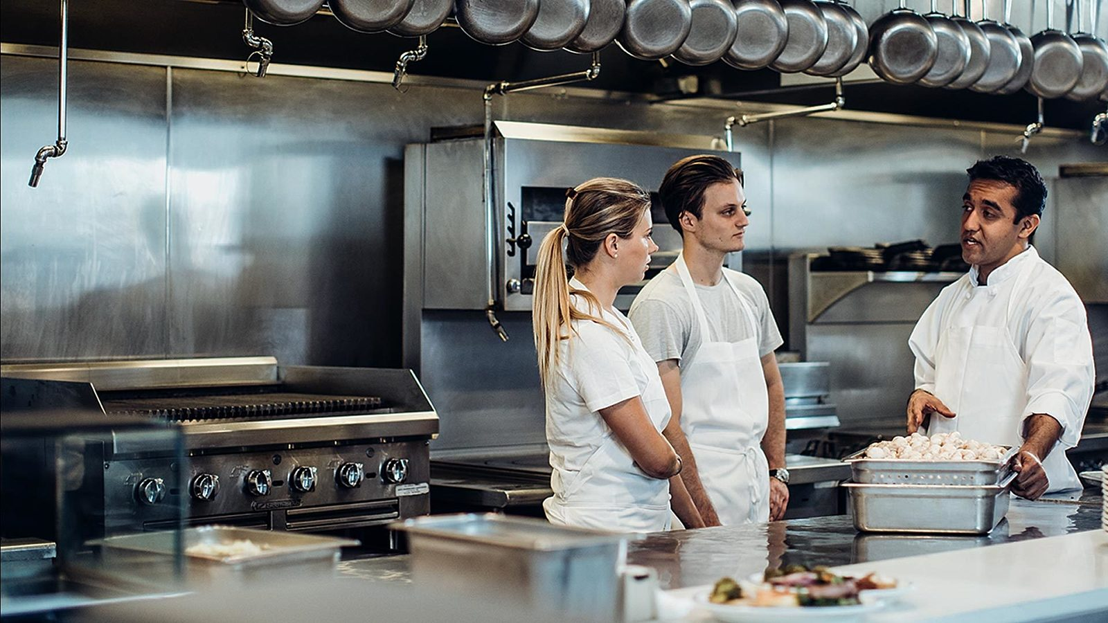 Millennials learning from a chef.