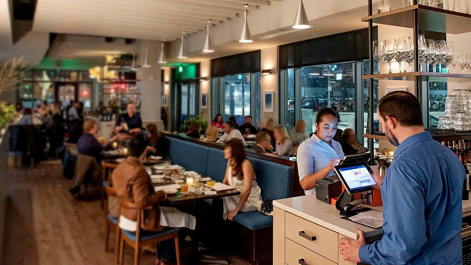 A busy restaurant dining area - How to Create a Restaurant Staff Schedule
