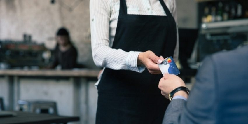 Closeup Image Of A Man Giving Credit Card To Waiter In Cafe 648543 Edited