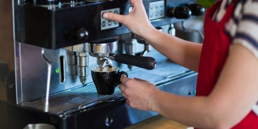 Mid Section Of Waitress Making Cup Of Coffee In Cafx92Xa9 597413 Edited