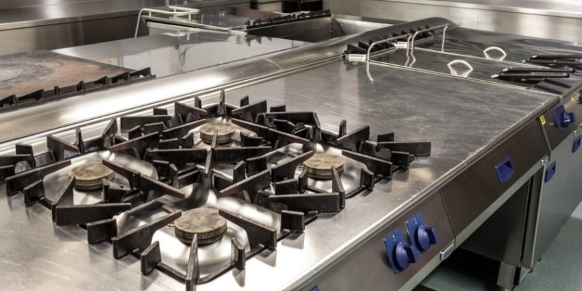 Picture Of Professional Kitchen Showing Gas Stove In Foreground 774818 Edited