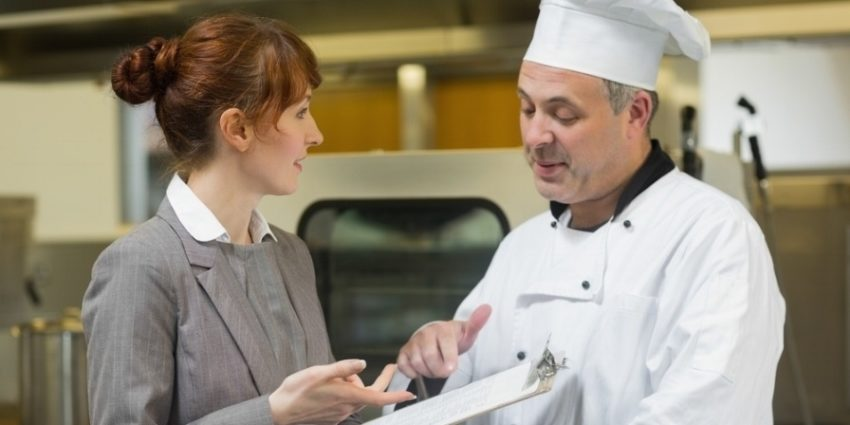 Young Female Manager Talking To The Head Cook Standing In A Professional Kitchen 875134 Edited