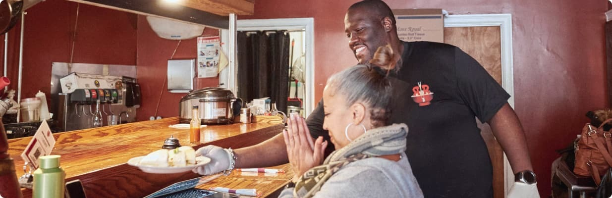 Guest happily getting their order at Roc-N-Ramen